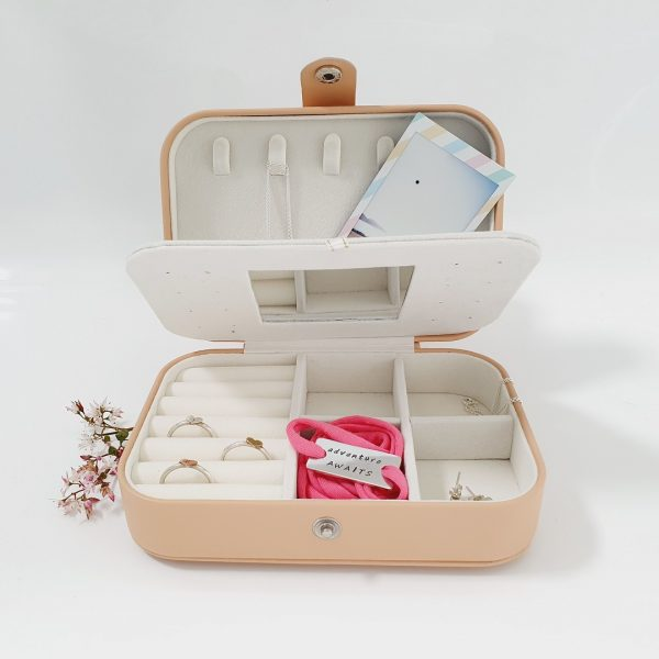 inside compartments of monogrammed jewellery boxes